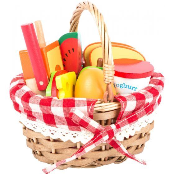 Cesta de pícnic con alimentos cortables