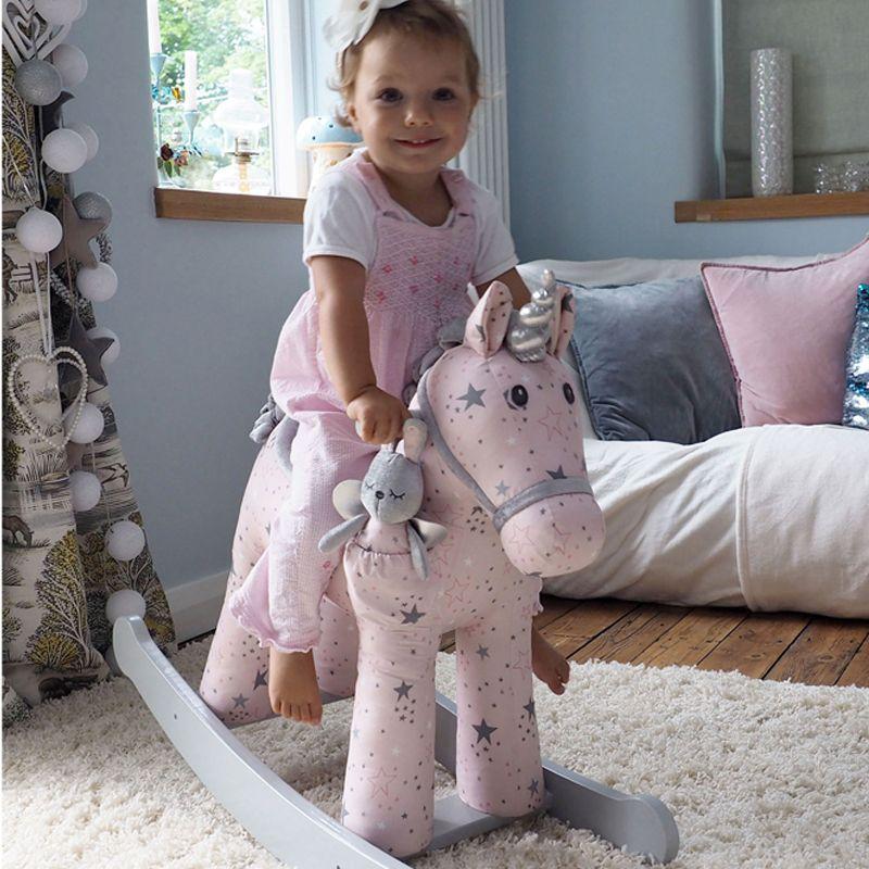 unicornio balancín rosa