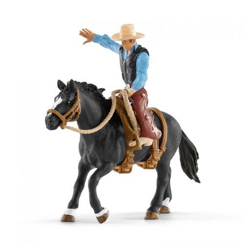 Caballo Bronco montado por Cowboy